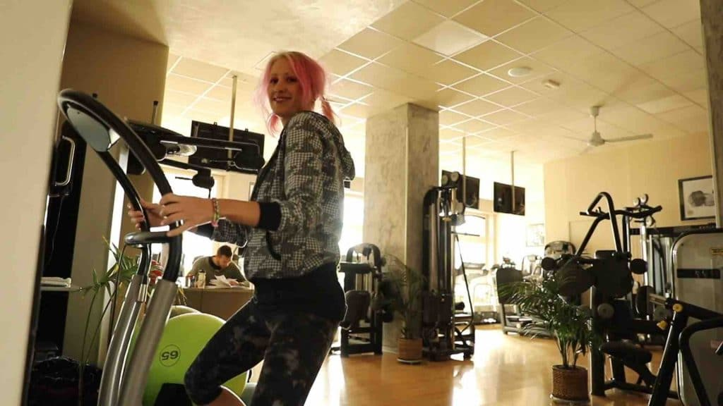 Picture of a Woman Using the Best Vibration Machine