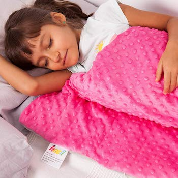 Picture of a girl sleeping with a padded quilt