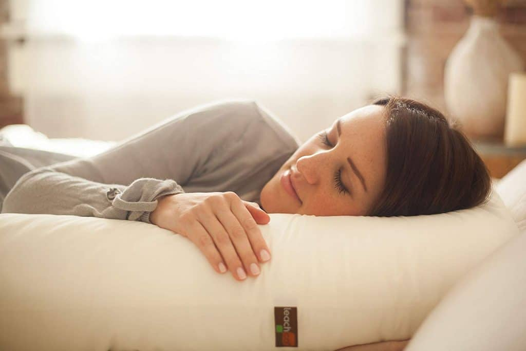 Picture of a woman sleeping on a body pillow