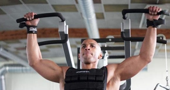 Picture of a man working out in a weighted vest