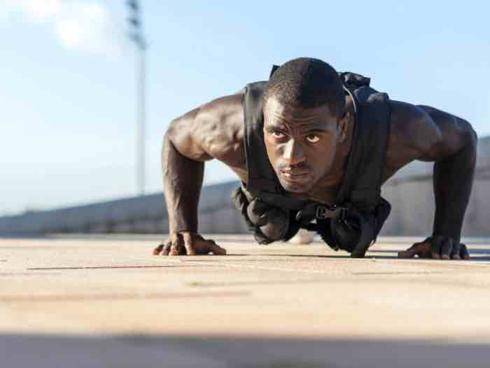 Pushups in a weighted training vest